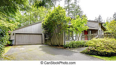 House exterior. View of entrance porch and garage - Grey big...