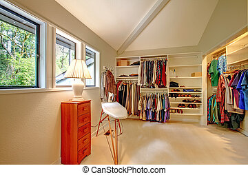 Spacious walk-in closet with built-in shelves. Closet full...
