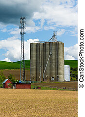 Grain silo with a cell phone tower