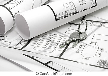 Key to housing - Key situated on blueprints of house -...
