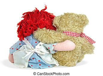 rag doll and teddy bear hugging - Old rag doll and teddy...