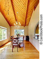 Beautiful dining area with high vaulted ceiling - Bright...