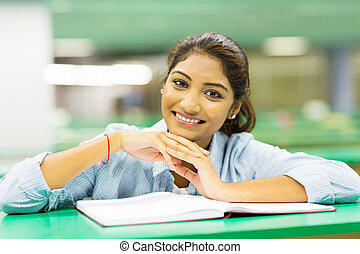cute female college student in library