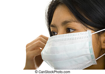 protective mask on young asian woman - asian woman putting...