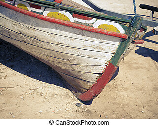 boat out of water - fragment of old wooden boat on the sand...