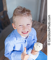 boy eating ice-cream - cheerful little boy eating ice-cream