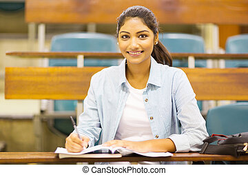 pretty female university student in lecture hall