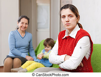 sadness mother and grandmother with baby after quarrel -...