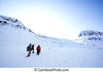 Winter Tourism - A group of people treking across a winter...