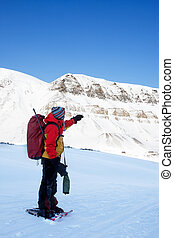 Adventure Guide - An adventure guide on snowshoes against a...