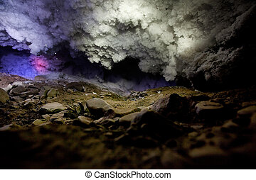 Ice Cave - A dark and mysterious snow ice cave - A glacial...
