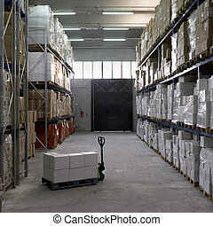 Merchandise Stocking - Boxes on pallets inside an industrial...