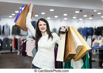 girl with shopping bags at clothing store