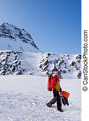 Female Mountaineer - A female mountaineer against a winter...