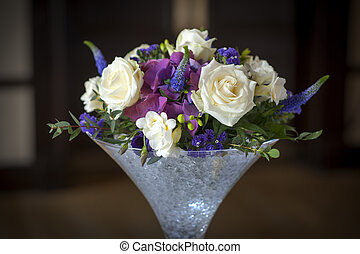 wedding centrepiece flowers white and purple