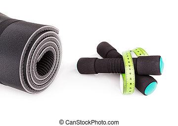 Sports equipment for fitness. Dumbbells, meter, mat.