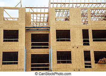 Wood Sheathing on Stud Framing - Wood sheathing panels on...