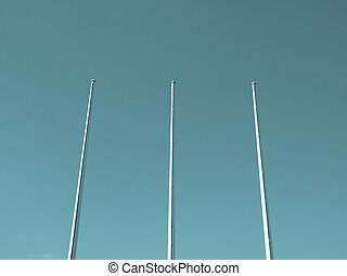 Flagpole flagstaff mast over a blue sky background - cool...