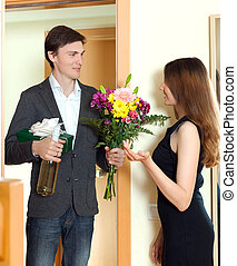 Man giving a gift box to his young wife