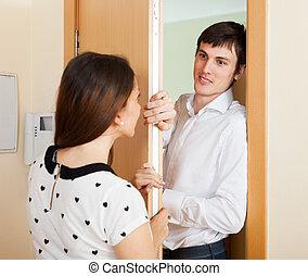 Persuasive social worker questioning girl at door