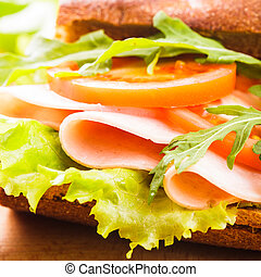 Wholegrain sandwich with ham, tomato, lattuce and arugula...