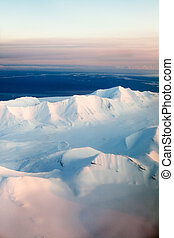 Snow Mountain - A mountain landscape filled with snow,...