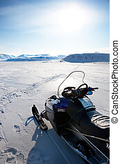 Snowmobile - A snowmobile on a winter landscape