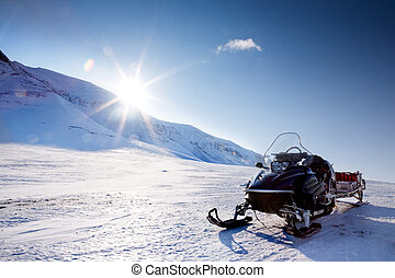 Snowmobile - A snowmobile in a winter mountain landscape