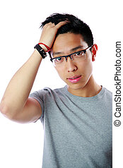 Portrait of a young serious asian man over white background