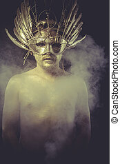 golden deity, man with wings and gold helmet