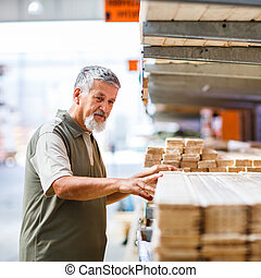 Man buying construction wood in a DIY store for his DIY home...