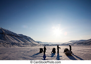 Winter Adventure Landscape - Three people on a winter...