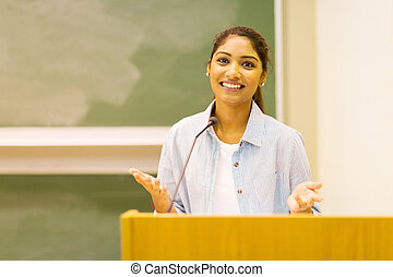 female college student giving a speech to lecture hall