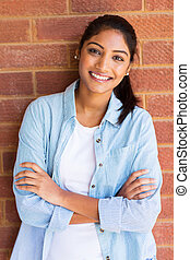 young indian university student with arms crossed -...