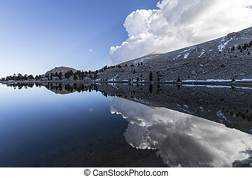 Cirque Lake Afternoon - Calm waters at Cirque Lake in the...