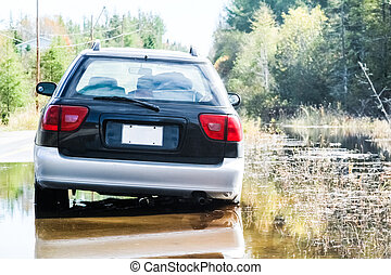 Car Stuck after a Water Flood on a Country Road