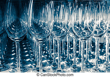 Many Empty Wineglasses Upside Down on a White reflective...