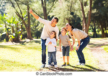 family bird watching in forest - happy young family bird...