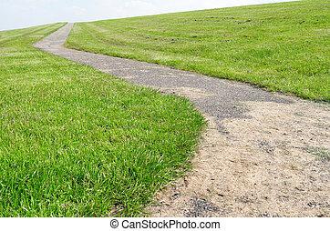 Dyke. - Walkway on a dyke in Lemmer, Netherlands.