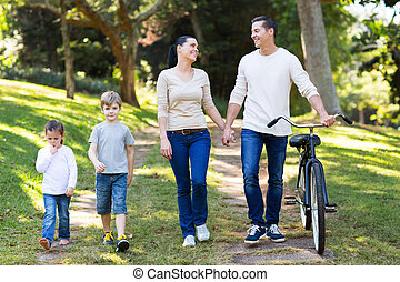 young couple and kids walking outdoors