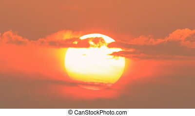 big sun going down close up sunset - huge sun going down at...