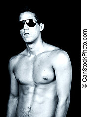 model - naked muscular male model with sun glasses, tone...