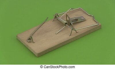 Wooden mouse trap. - Wooden mouse trap rotating on a green...