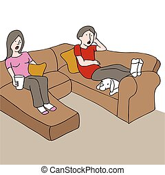 Surprised Couple On Couch - An image of a couple sitting on...