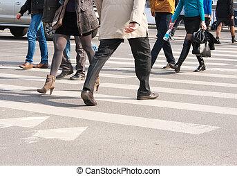 pedestrians cross the street at the crossroads
