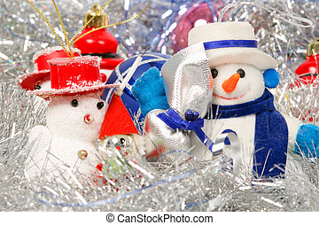 Snow man and Chrismas balls on silver background