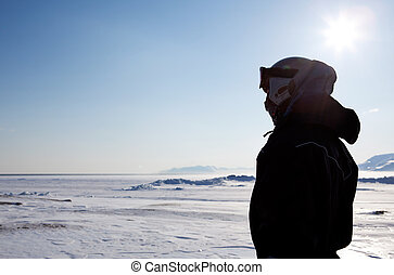 Man on Winter Landscape - A man wearing winter clothing...