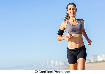 woman jogging in the morning - pretty woman jogging on the...