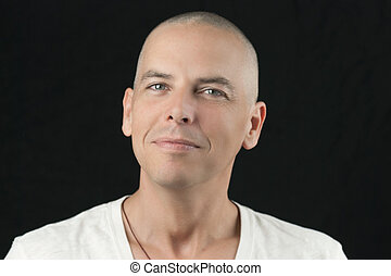 Newly Shaved Head, To Camera - Close-up of a man with a...