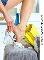 Woman fitting high heel shoes - Closeup photo of female leg...